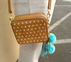 Pom-poms make the cutest addition to your bag - Pick up this #Fossil purse for $40 & add the poms for $4.99! | www.platosclosettucson.com