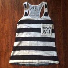 Crooks & Castles striped tank top In excellent condition. Only worn once. It's hip length. The front is striped and the back is a blue camo. Great with jeans or cut offs. Crooks and Castles Tops Tank Tops