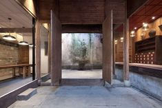 Anyscale made subtle interventions to this centuries-old building in China to transform it into the Wuyuan Skywells hotel, which features original details. In China, Chinese Architecture, Architecture Design, Provinces Of China, Building Renovation, Hotels, Hotel Interiors, Restaurant Interiors, Design Interiors