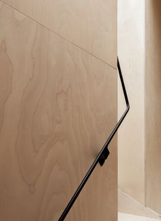 Plywood wall panelling and metal handrail
