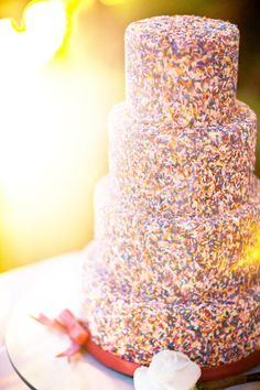 #Sprinkles Wedding Cake ;) Glass Jar Photography  | See more on Style Me Pretty: http://www.stylemepretty.com/2012/11/28/destination-las-vegas-wedding-from-glass-jar-photography/