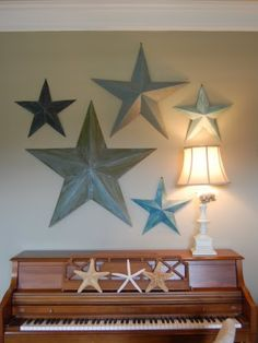New idea for my wall...Metal stars on my wall, but different sizes and color!  And I know where to put them!