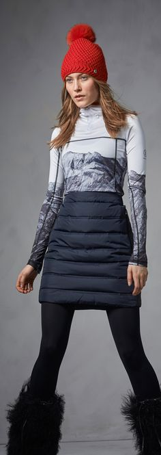 Snow bunny alert! Pulling off a wintery, feminine and still athletic look for the après ski party is no small feat. Make it a touch easier with a warm, stunning quilted down skirt: the horizontal quilting accentuates your natural curves and the down is there to keep all your vitals warm. Wear it with a sporty-meets-artsy first layer top featuring the work of photographer Ray Demski and a classic pair of black leggings, and warm, fluffy boots.