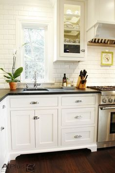 Contemporary Kitchen with Rejuvenation Small Oval Cupboard Latch, L-shaped, Flat panel cabinets, Soapstone counters