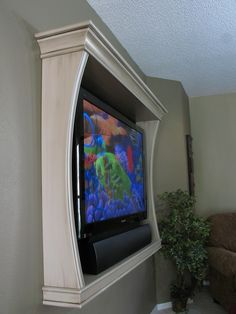 tv frame..love this ... @ MyHomeLookBookMyHomeLookBook