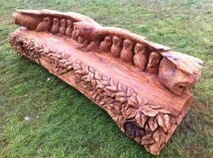 Chainsaw carving by Tommy Cragg - This guy has mad skills! Carved owl bench.