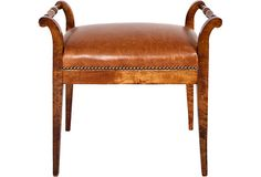 Lovely small leather bench.  Would work well in a library or small sitting room.