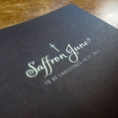 A close-up of the reverse of an A5 invitation, printed on yellow card with a chocolate solid reverse.