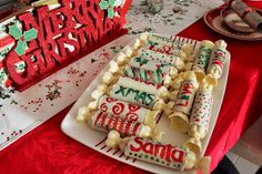 Chocolate Christmas Crackers. White Chocolate Cracker filled with Chocolate Raspberry Mousse and a surprise pop!