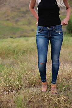 Flying Monkey Brand jeans with stretch. They have slit knees on both sides and a faded denim wash. *True to size