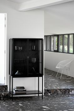 A solid black frame contrasts with the glass surface for a fresh twist on traditional cabinetry. The glass doors are the defining feature feature, and ample shelving maximizes storage and display options. Standing high, its beautiful design allows for amp Metal Storage Racks, Metal Storage Cabinets, Ikea Storage, Door Storage, Cupboard Storage, Locker Storage, Media Storage, Storage Organization, Storage Ideas