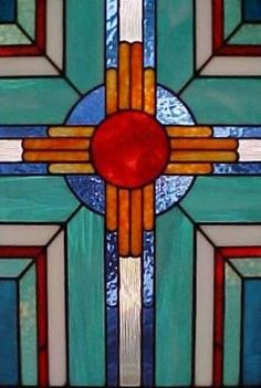 Stained glass cross in teals and orange