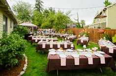 Banquet tables set in an angled pattern rather than straight/grid-like to add a decorative look to a backyard wedding reception
