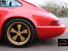 Porsche 964 sitting on gold Fuchs