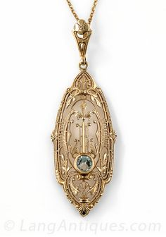 Art Deco Aquamarine Pendant Necklace, A single pale blue aquamarine gleams from within this striking and unusual Art Deco pendant necklace, die-struck and hand finished in rich 14K yellow gold - circa 1930s. Fanciful foliate and geometric filigree coalesce for an enchanting neoclassical effect.