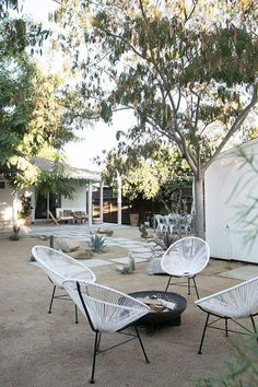 Acapulco chairs pair well with the dry landscaping in this California backyard. Desert Backyard, No Grass Backyard, Modern Backyard, Backyard Landscaping, Backyard Ideas, Landscaping Ideas, Patio Ideas, Oasis Backyard, Backyard Chairs