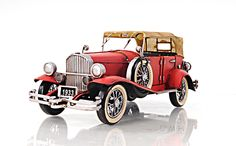 """CaptJimsCargo - 1933 Red Duesenberg SJ Metal Desk Top Car Model 14"""" Automobile,  (http://www.captjimscargo.com/model-tether-cars-automobiles/1933-red-duesenberg-sj-metal-desk-top-car-model-14-automobile/) The mirrors, spare tires and all other accessories are welded into position (no parts are glued on). The wheels roll."""
