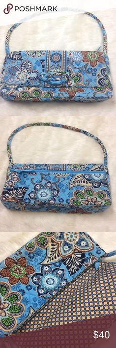 Vera Bradley Knot Just a Clutch Bali Blue Handbag Length 12.5 inches. Height 6.5 inches. 2 inside slip pockets. 1 inside zipper pocket. 1 outside zipper pocket. Strap drop 9.5 inches(detachable strap). No flaws. Vera Bradley Bags Shoulder Bags
