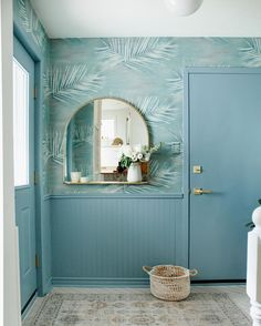 Foyer Furniture, Entryway Rug, Refinish Staircase, Double Staircase, How To Install Wallpaper, Arch Mirror, Herringbone Tile, Mirror With Shelf, Summer Wallpaper
