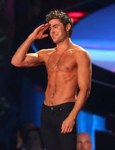 Zac Efron on stage after winning the Best Shirtless Performance category at the MTV Movie Awards ~ April 13, 2014