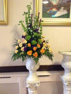 Modern Pedestal Arrangement with Orange Yellow Green & Purple Flowers