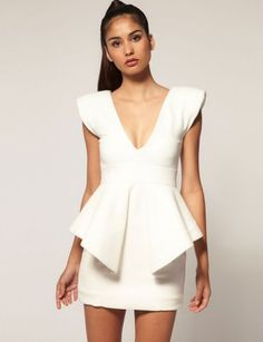Peplums.... I've gotta find a way to pull this off.  Not as dramatically as shown, but I absolutely love a peplum.