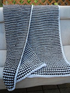 """Houndstooth Blanket, crocheted by knotalot from the *free* """"Houndstooth Pet Scarf"""" pattern by Claire Ortega (pattern link on Ravelry page). The pet scarf is pretty cute, too :-) Easy pattern worked with SC DC. #crochet #afghan #throw"""