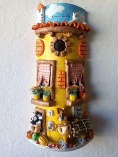Teja decorada con burro cargado de leña
