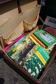 Garage Sale Idea: use old suitcases to display your merchandise; make sure to put a prominent price tag.