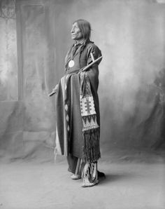 """Figure 4 Chief Wolf Robe wearing the peace medal given to him by Benjamin Harrison. Wolf Robe holds a ceremonial pipe often called a calumet or """"peace pipe"""". Courtesy of Western History Collections, University of Oklahoma Library. Native American Regalia, Native American Warrior, Native American Images, Native American History, Cheyenne Tribe, Cheyenne Indians, Plains Indians, Wolf, Native Indian"""