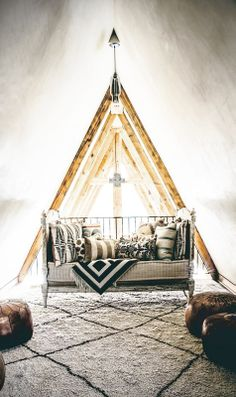 A-frame little room with pillows in mixed patterns