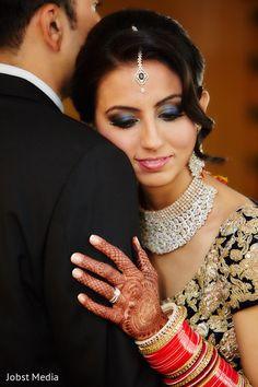 Indian bride hugging the groom photography before wedding reception http://www.maharaniweddings.com/gallery/photo/114163