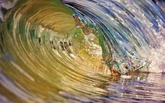 The swell of the water, the familiar tube - this looks like a perfect surfing wave, but it is only a couple of centimetres high. Photographer DebM specialises in capturing tiny waves breaking on the Australian coast in what she calls Waveart. We will have a gallery of her tiny waves on the Telegraph site later today.