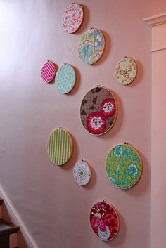 embroidery hoop art with fabric by Inspired by Charm. They resemble vintage plates... cool!