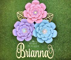 Stunning paper flower wall art! #nurserydecor #paperflowerwallart #nurseryideas #babyshower #babyshowerideas #unicornbirthdayparty #unicornparty