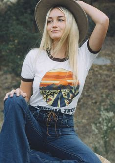 We've got those California desert vibes with our Joshua Tree ringer t-shirt. Tee is a natural white with contrasting brown ringer neck and sleeves. 70's inspired graphic and color scheme. Joshua Tree,