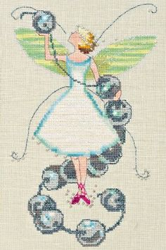 Stitching Fairies Bead Fairy is the title of this cross stitch pattern from Nora Corbett's Stitching Fairies series.