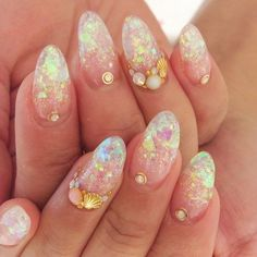 I noted that mermaid nail design is quite popular these cold days. Because... The winter, you know. Girls are dreaming about the hot summer, relaxing on a sea beach ♥  #evatornadoblog #iloveit #mustpin #mycollection @evatornado