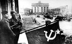Battle of Berlin - after the conquest of Berlin by the Red Army in May 1945, Soviet soldiers hoisted the Soviet flag on a house in the Unter den Linden boulevard.