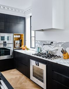 """My husband is form, and I'm function,"" says Abbey. ""He focused on the design aesthetic [of the kitchen] — the marble countertops and the island, for example. I focused on working out where everything should go."