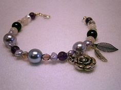 Handmade Purple Goddess Glass Beaded Bracelet with Etheric Mother Earth Leaf, Amethyst gemstones and Silver coloured Angel Feather