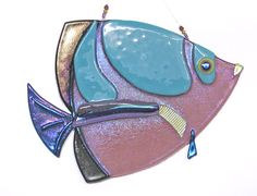 www.blueheronglass.net has a great selection of glass fish for sale