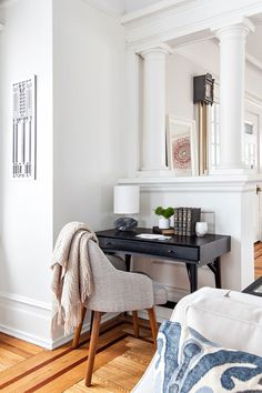 """How could you possibly work at this desk? The <a href=""""http://www.westelm.com/products/saddle-dining-chairs-h429/?pkey=e%7Csaddle%2Bdining%7C3%7Cbest%7C0%7C1%7C24%7C%7C1&cm_src=PRODUCTSEARCH"""" target=""""_blank"""">chair</a> looks far too comfy, and the <a href=""""http://www.cb2.com/chamfer-marble-table-lamp/s437540"""" target=""""_blank"""">little marble desk lamp</a> is too cute!"""