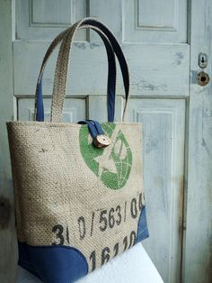 Burlap coffee sacks are strong, rugged and chic when upcycled into a tote bag like this one! They're the right blend of rustic elegance and eco-cool, and of course, the perfect way to display your java love while shopping at the farmer's market, lounging at the beach or hanging out at your favorite outdoor music festival.    Get your's today!     https://www.etsy.com/listing/104865692/upcycled-leah-tote-everyday-bag-book-bag?ref=pr_shop