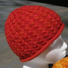 Dean Street Hat - from Nina Machlin Dayton, unisex cabled hat, with two narrow edge treatments, rolled or ribbed, and 3 sizes, small (childs), adult medium, and adult large.
