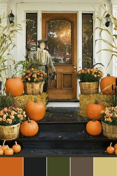 Fall porch - a little busy for me but like the hay