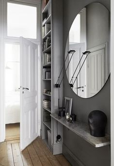 Small entryway mirror entryway mirror ideas entryway mirror with shelf hallway shelf best hallway mirror ideas . Gravity Home, Interior, Hallway Mirror, Home, Old Apartments, Grey Hallway, Stockholm Apartment, Grey Walls, Interior Design