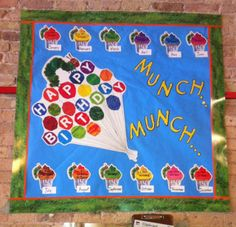 "Happy Birthday! This board contains mixture of Carson Dellosa's Eric Carle ""The Very Hungry Caterpillar Birthday"" bulletin board set & ""Squiggly Green"" border, Eureka's 4"" ""Peanuts"" letters, and TREND's orange border"