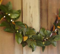Lit Magnolia Garland | Pottery Barn - so pretty.