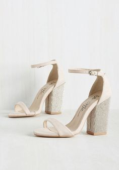 How could one walk away from this pair of blush heels? It's simply impossible! From the moment you lay eyes on these sultry sandals, with their bejeweled block heels and delicate ankle straps, you know that this faux-suede pair will be strutting with you wherever you go.